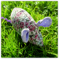A floral field mouse. Mouse pin cushion