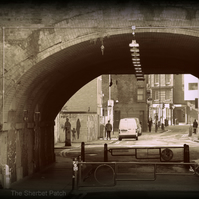 Under the archway,  Shoreditch.  A photographic print.