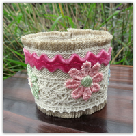 A linen and lace fabric cuff bracelet.