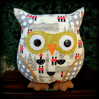 Bertie, a 24cm tall London themed owl cushion.