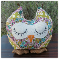 Hibiscus, a snoozy owl doorstop.  Owl bookend.