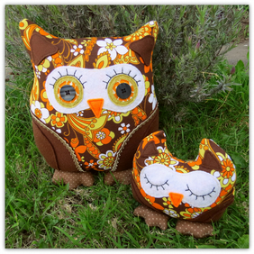 A set of two groovy retro owls.   A 36cm tall cushion and a doorstop.  Marigold.
