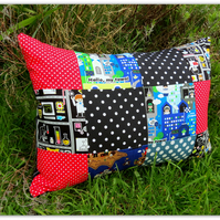 Pirates, space and all things science. A patchwork cushion with inner pad.