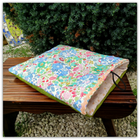 A Liberty Lawn patchwork ipad sleeve.  Handsewn patchwork in a hexagon design.