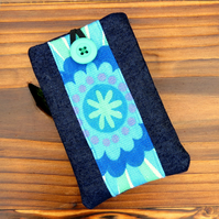A mobile sleeve,  iphone sleeve.  1970s flower power and denim.