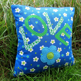A groovy flower power cushion, complete with feather pad.
