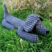 Basil, a soft tweed sausage dog doorstop.