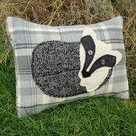 SALE!   A badger cushion, complete with feather pad.