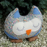 Milly, a snoozy owl doorstop.  Owl bookend.