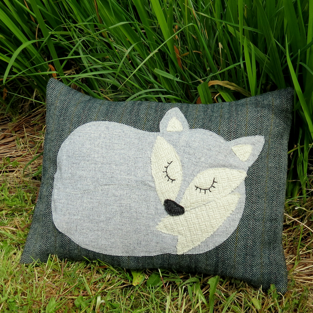 Little grey fox.  A snoozy fox cushion on tweed wool.  With a feather pad.