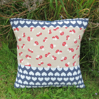 Wish upon a toadstool.  A cushion complete with feather pad.