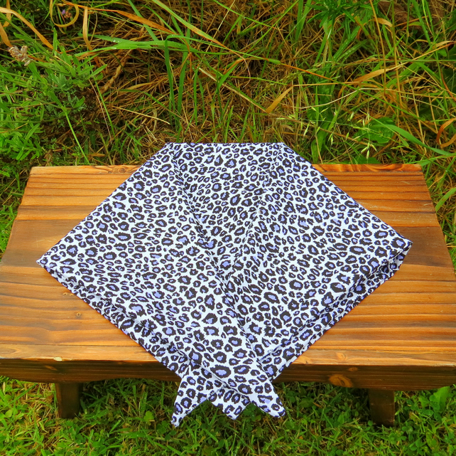 A doggy bandana.  Size large,  75cm x 28.5cm.  Animal print.