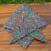 A doggy bandana.  Size XS, to fit a toybreed dog or puppy.  Liberty Lawn.