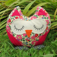Flora, a snoozy owl doorstop made from Liberty Lawn.
