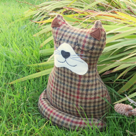 Alfred. A snoozy cat doorstop, made from a tactile tweed wool.