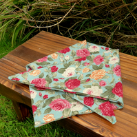 A floral dog bandana.  Size medium.  61cm x 25.5cm.