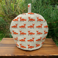 A whimsical fox tea cosy.  Size small, to fit a 2 cup teapot.