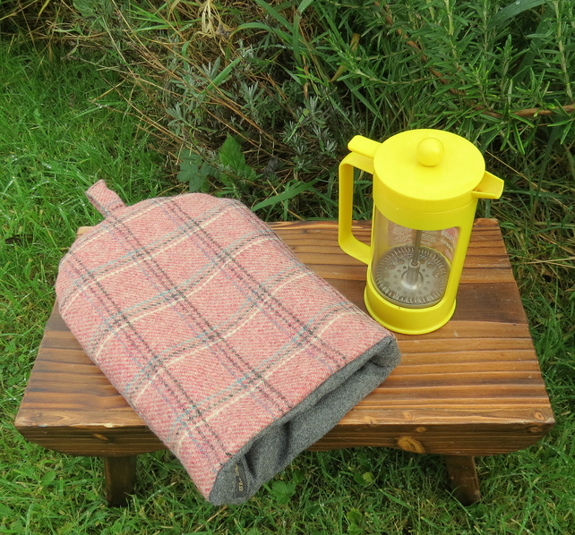 A cafetiere cosy, made from a tartan wool. Size small, to fit a 2 cup cafetiere.