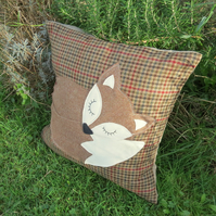 Snoozy fox.  A large statement cushion, complete with feather pad.