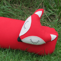 Long fox.  A red fox draught excluder, made from tactile wool.
