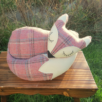 A snoozy fox doorstop, made from tactile tartan wool.
