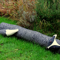 The quirky badger.  A woollen badger draught excluder.