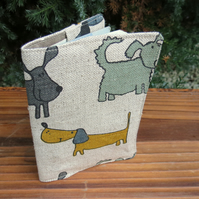 Dogs.  A passport sleeve with a whimsical dog design.