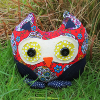A whimsical owl doorstop.  Made from a vibrant Sugar Skulls cotton.