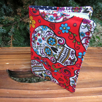 Skulls.  A passport sleeve made from a vibrant Sugar Skulls cotton.