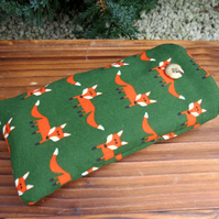 Foxes.  A glasses sleeve with a whimsical fox design.