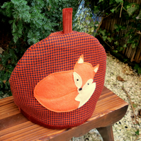 Orange fox.  A tactile wool tea cosy.  Size medium, to fit a 4 cup teapot.