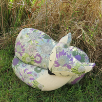 Lavender blue.  A snoozy fox cushion, made from Liberty Lawn.