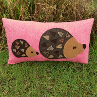 Hedgehogs.  A tactile wool cushion, complete with cushion pad.  Hedgehog cushion