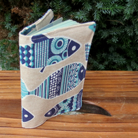 Blue fish.  A passport sleeve with a whimsical fish design.  Passport cover.