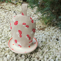 SALE!  A whimsical egg cosy.  Toadstools design.