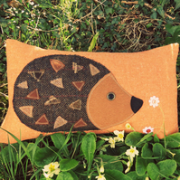 Hedgehog.  A tactile wool cushion, complete with feather pad.