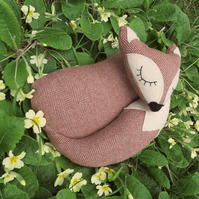 Snoozy fox.  A fox doorstop, made from a tactile herringbone wool.