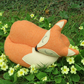 Orange fox.  A snoozy fox cushion, made from a tactile vintage wool.