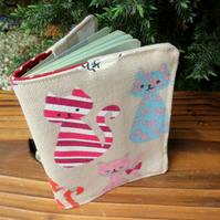 Cats.  A passport sleeve with a whimsical cats design.