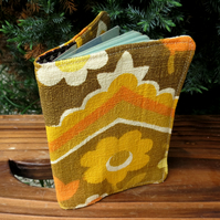 A passport sleeve, made from a groovy 1960s barkcloth fabric.