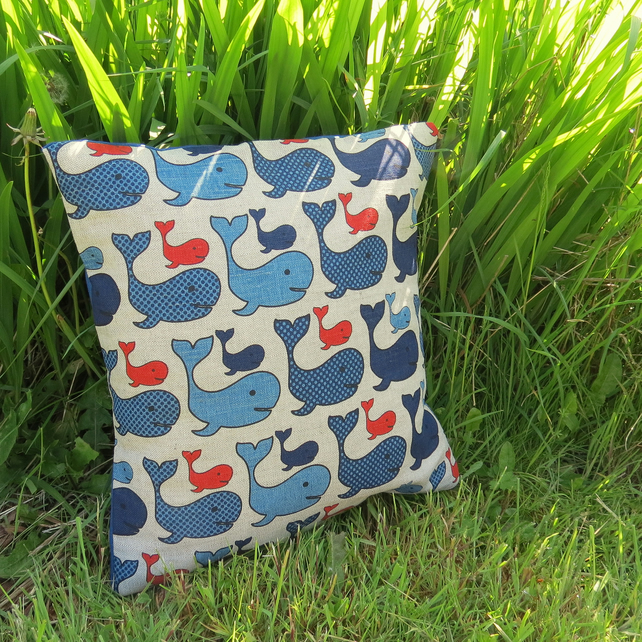 A nautical cushion, complete with feather pad.  Whales.  Nursery decor.