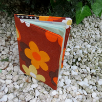 A groovy flower power passport sleeve.  Made from a vintage 1960s fabric.
