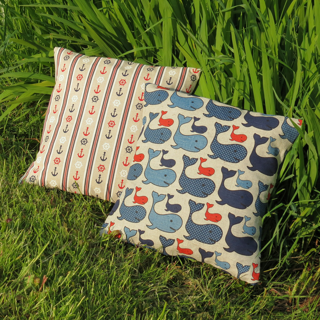 A set of two nautical cushions.  Complete with feather pads.