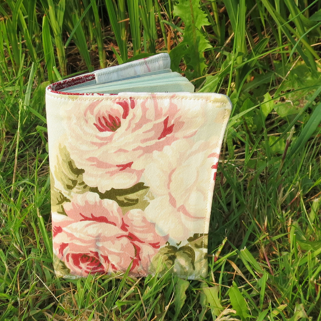 Blowsy roses.  A passport sleeve with a cottage garden design.