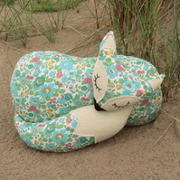 A snoozy fox cushion, made from a floral Liberty Lawn.