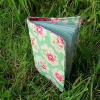 Flower.  A fabric passport sleeve.  Passport cover.
