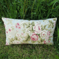 Blowsy roses.  A floral cushion, complete with cushion pad.