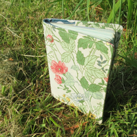 A botanical passport sleeve.  Made from a Moygashel cotton.