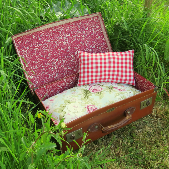 A quirky pet bed.  Made from a vintage 1940s suitcase.  Cat bed.  Dog bed.