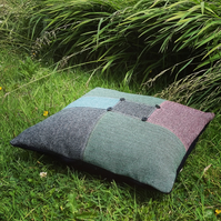 A large statement floor cushion, made from tactile wool.   With feather pad.